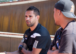lewis jetta of the west coast eagles talking to program participant at wirrpanda employment program