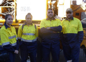 group of adult employment participants in high vis
