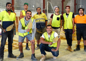group of adult men in work wear at building training couse