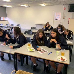 group of deadly sista girlz in classroom doing activities